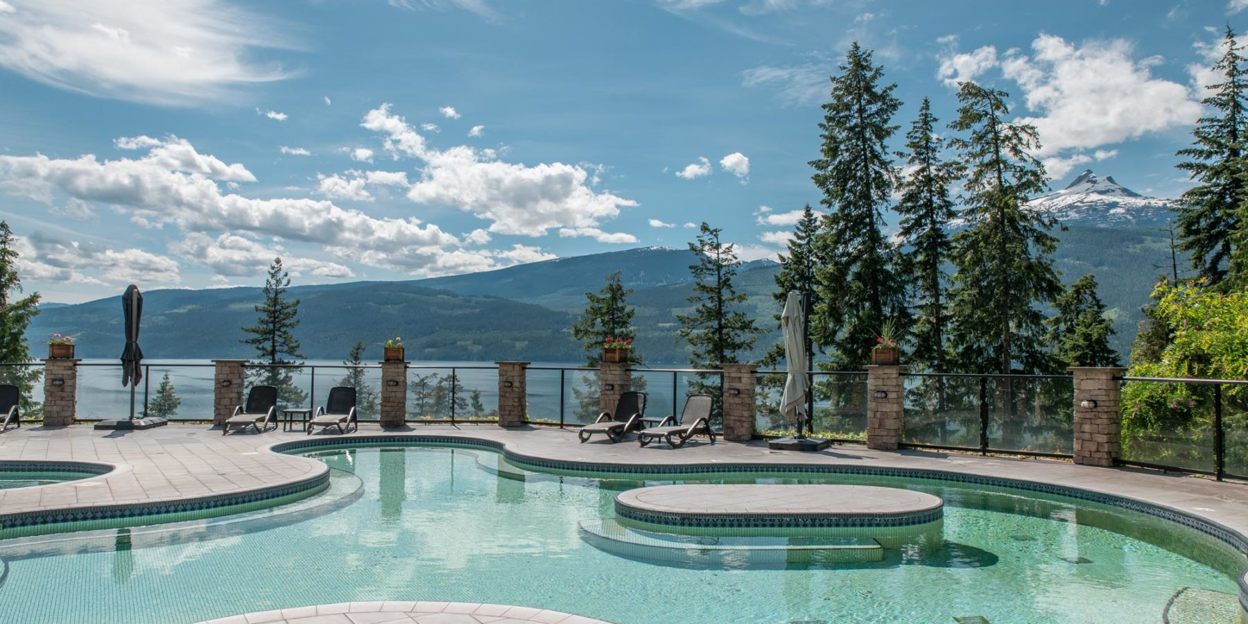 The pools at Halcyon with mountains in the background